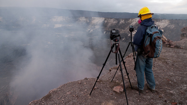 Geologist in mask overlooking Halemaumau_property of Ben Gaddis