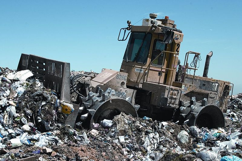 Heavy machinery at work at a landfill