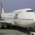 A Japan Airlines 747 waits at the gate. Image courtesy of Wikimedia Commons.