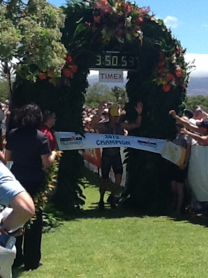 Lance Armstrong crosses the finish line first at the Ironman 70.3 Hawaii (Honu). Photo by Tom Newhouse