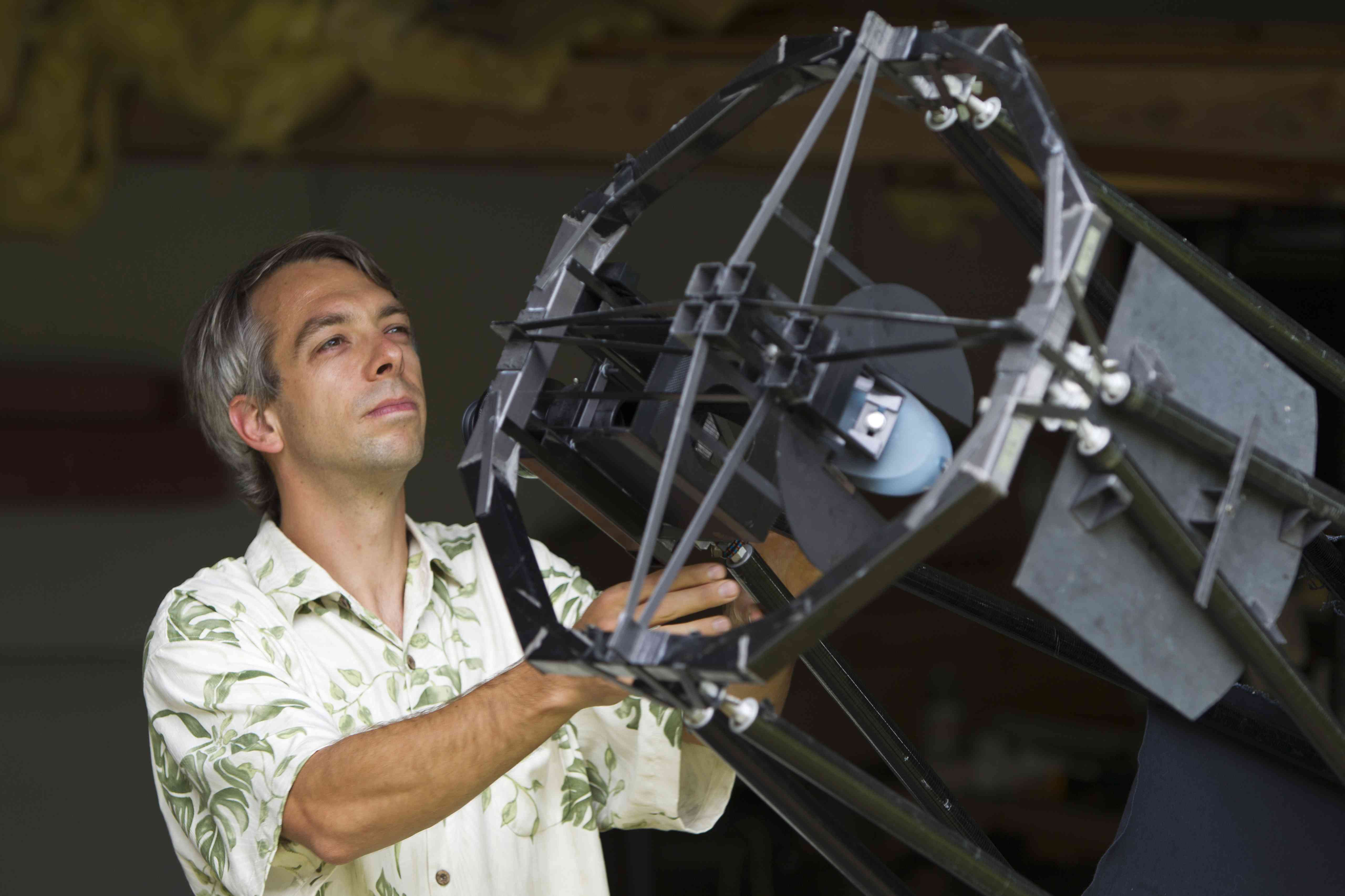 Astronomer and 2012 MacArthur Fellow Olivier Guyon works on a home-made telescope in his garage in Hilo. Photo by Marco Garcia/Getty Images for Home Front Communications.