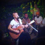 Nahko performing at the Kava Bar in Hilo. Photo by Kristin Hashimoto.