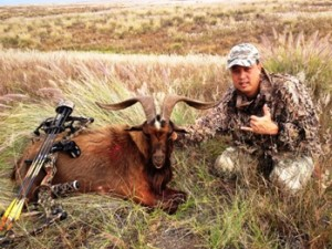 Lloyd Rubio is shown with a goat he shot hunting in the Saddle Road area on Nov. 17. Photo courtesy of US Army Garrison Pohakuloa.