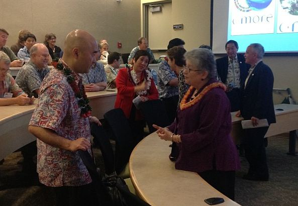 Participants at today's Inouye Tribute Legacy Ceremony included the late senator's son, Ken, shown at left speaking with UH President M.R.C. Greenwood. US Rep. Colleen Hanabusa is shown at center in red. UH photo.