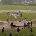 Hilo High baseball players rushed out to cover the mound and home plate as soon as the KS-Maui / KS-Hawaii game ended. Photo credit: Josh Pacheco