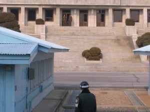 A South Korean soldier stares at his North Korean counterparts in a neutral portion of the DMZ separating the two countries.