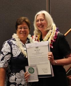 Sen. Malama Solomon presents the award to Mary Begier of the Hawaii Island Chamber of Commerce. Courtesy photo.