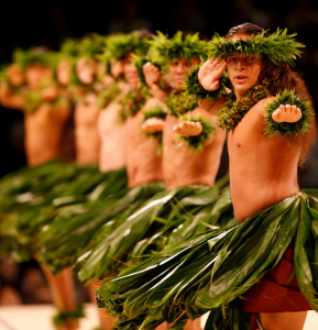 A kane or men's halau performs in a previous kahiko competition.
