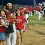 Coach Estrella is joined by his wife, Geri (left), and daughter Allyson (right). Photo courtesy: UHH Sports Information.