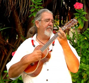 "Local musician Robert Yates, known as Uncle ""Uke,"" offers handcrafted ukuleles at his new store. Photo courtesy of the Kings' Shops."