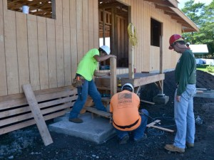 Hawaii Community College carpentry instructor Darryl Vierra (right) oversees work done on the model home. HCC photo.