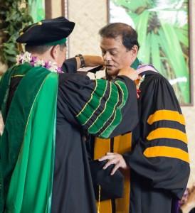 University of Hawaii Regent Barry Mizuno, left, presents Hawaiian studies professor Kalena Silva with the Board of Regents Award for Excellence in Teaching. Courtesy photo.
