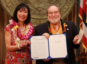 Gov. Neil Abercrombie is accompanied for the bill signing by Karen Korematsu, daughter of the late Fred Korematsu, one of the Japanese-Americans prosecuted for refusing to report to an internment camp.  She is also co-founder the Fred T. Korematsu Institute for Civil Rights and Education.