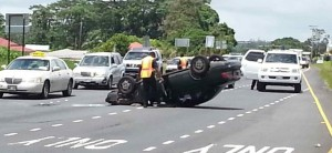 This accident snarled noontime traffic today fronting the Puainako KTA supermarket. Photo by Dave Smith.