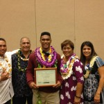 KS-Hawai`i graduate Shaun Kagawa (middle) is flanked by family at Sunday's ceremony. Photo by Josh Pacheco.