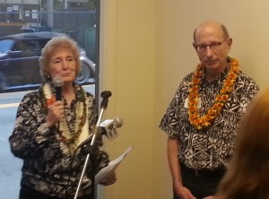 Immigrant Resources Center Coordinator Linda Spencer, left, and Catholic Charities Hawaii CEO Jerry Rauckhorst speak during today's dedication. Photo by Dave Smith.
