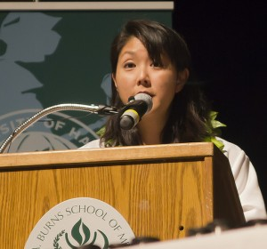 Dr. Melani Arakaki, shown addressing new medical students at a recent ceremony, is a Hilo-area native who decided to practice medicine locally after graduating from UH's Family Medicine Residency Program. JABSOM photo.