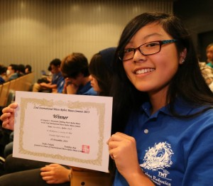 Erin Morikawa shows the certificate awarded for her team's first-place showing in the Mountain Climbing Micro Robot Maze. Courtesy photo.