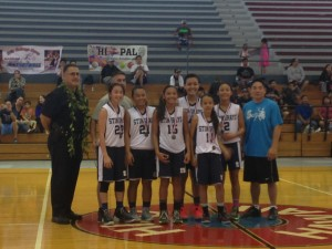 The Stingrays 14 and under girls basketball team takes its championship photo after defeating Wahine Ryders. Photo by Josh Pacheco.