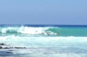 Surfers in December at Lyman's along Alii Drive. File photo.