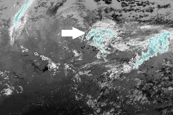 The arrow in this infrared satellite image shows the low-pressure system that has moved to the east of the Big Island. NOAA/NWS image.