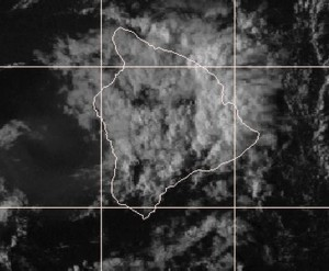 This satellite photo taken at 4:15 p.m. shows clouds towering above parts of East Hawaii. NOAA/NWS image.