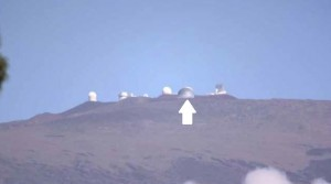 A simulation of how the Thirty Meter Telescope (arrow) would look near the summit of Mauna Kea through a telephoto lens from Waimea. Source: final environmental impact statement, Thirty Meter Telescope Project.