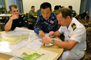 RIMPAC personnel planning humanitarian assistance and disaster relief exercises. US Navy photo.