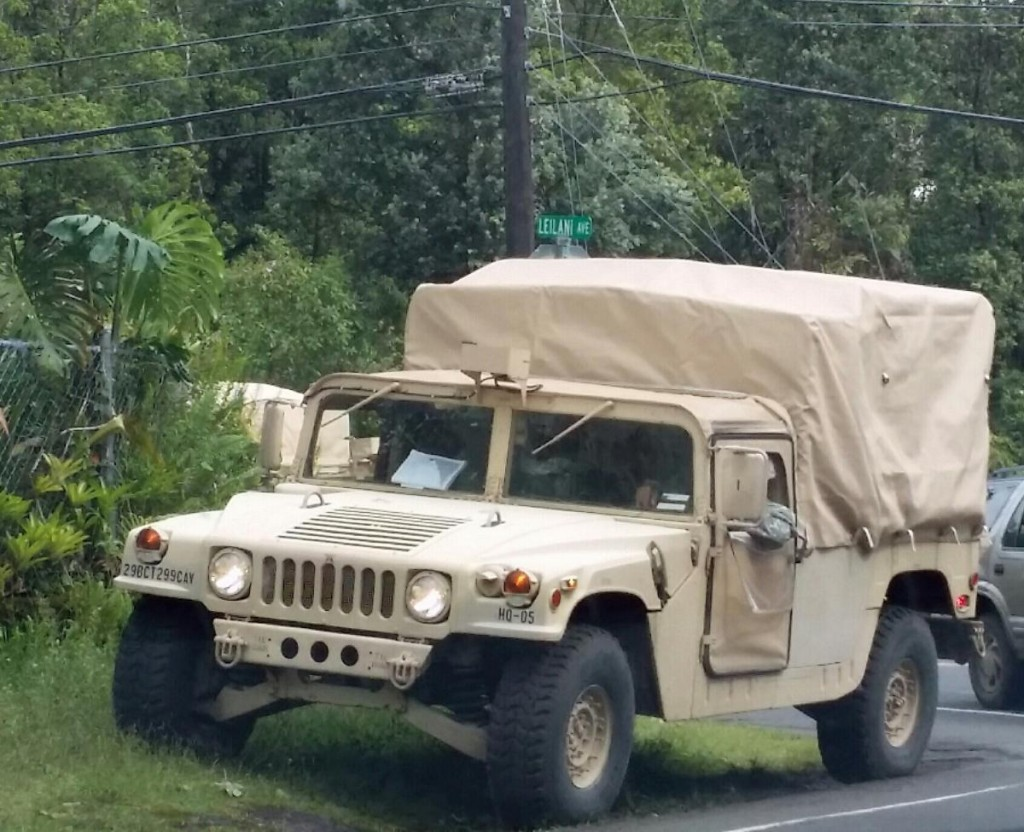 A Humvee from the Hawai`i National Guard sits along the side of a road in Hawaiian Paradise Park. Photo by Kristin Hashimoto.