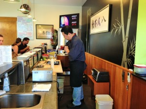 A view of the Takenoko Sushi dining room, chef Igarashi at work. Photo by M's Photography.