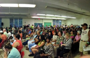 A large crowd gathers to hear the latest updates on the June 27 flow threatening the Puna district. Photo by Nate Gaddis.