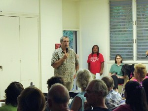 Civil Defense chief Daryl Oliveira addresses a large crowd in Pahoa about the June 27 lava flow threat. Photo by Nate Gaddis.