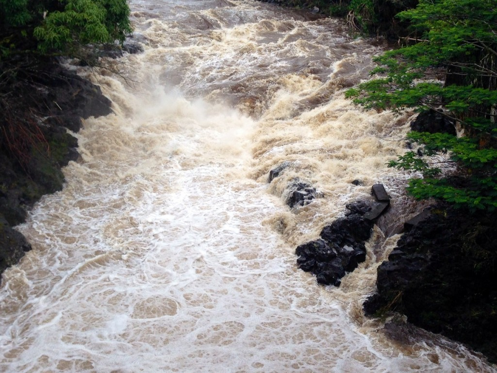 Wailuku River rages as rain begins to fall during Hurricane Iselle. Photo by Nate Gaddis.