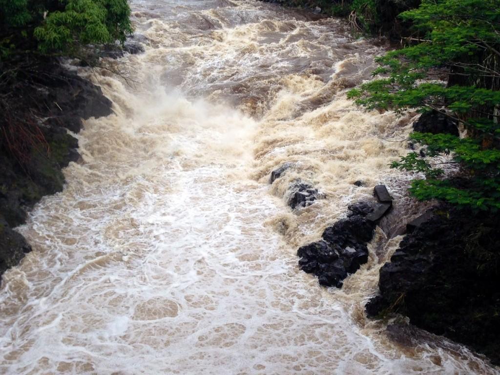 Wailuku River rages as rain begins to fall during Hurricane Iselle. Photo by Nate Gaddis.