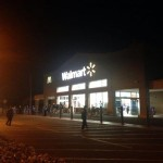 Walmart employees remained outside of the store hours after a clothing fire closed it down Tuesday afternoon. Photo credit: Josh Pacheco.