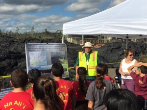 Students gather around a presentation during Monday's student tour of the Pahoa Transfer Station. DOE photo.