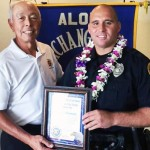 Officer of the Month Kaeo Drummondo (right), posing with Aloha Exchange Club of East Hawai'i board member Joey Estrella. HPD photo.