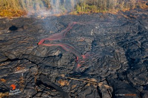 This photo taken Jan. 10 shows a large breakout about 300 yards upslope of the distal tip, poured lava onto the flow field.  Photo: Extreme Exposure Media/Paradise Helicopters.