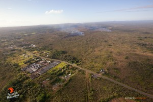 The distal tip of the flow that had been threatening the Pahoa Marketplace remains stalled, while activity upslope continues. The northern lobes continue to advance. Photo: Extreme Exposure Media/Paradise Helicopters.