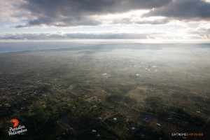 This photo taken on Jan. 14 shows light and variable winds, coupled with an inversion layer, trapping vog and smoke close to the ground in the HPP area. Photo: Extreme Exposure/Paradise Helicopters.