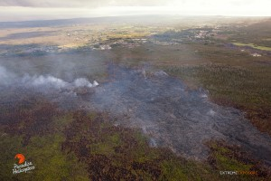 This photo taken on Jan. 14 shows a branch from the flow that threatened the Pahoa Marketplace, that was active and slowly approaching the firebreak Tuesday. The flow's outer edges continue to expand as well. Photo: Extreme Exposure Media/Paradise Helicopters.