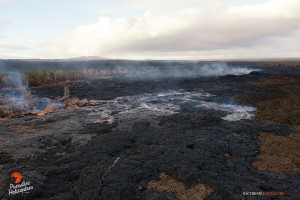 This photo taken on Jan. 22 shows a substantial breakout that was active about 4 miles downslope of Pu'u 'O'o crater, spilling lava in the middle of the flow field. Photo credit: Extreme Exposure/Paradise Helicopters.