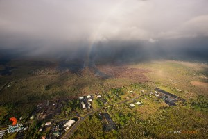 A rainbow shines above the distal portion of the June 27 lava flow in this overflight photo taken on Jan. 28. Photo credit: Extreme Media Exposure/Paradise Helicopters.