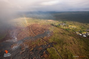 This overflight photo taken on Jan. 28 captured a rainbow above the lava bed. Photo credit: Extreme Exposure Media/Paradise Helicopters.