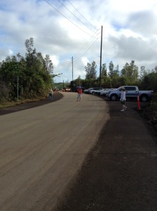 Vehicles line Apa'a Street as members of the public park and walk to the Pahoa Transfer station viewing area. Photo credit: Jamilia Epping.