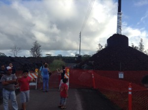 Members of the public venture from the Pahoa Transfer station structure and take a look at the impacted road. Photo credit: Jamilia Epping.