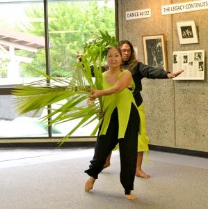 Faculty Trina Nahm-Mijo and Manaiakalani Kalua perform at the art exhibit opening. UH Hilo photo.