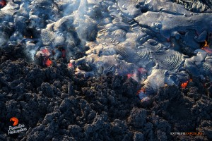 This photo taken on Feb. 4 shows a large breakout of pahoehoe near the perched channel, begins to cover an old 'a'a flow. Photo credit: Extreme Exposure/Paradise Helicopters.