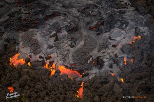 In this photo taken on Feb. 9, a pahoehoe flow covers a field of 'a'a about a mile downslope of Pu'u 'O'o. Photo credit: Exptreme Exposure Media/Paradise Helicopters.