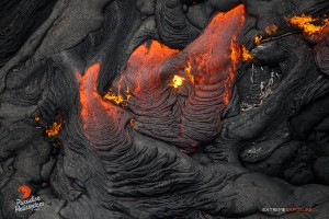 A burning tree trunk gets consumed by pahoehoe in this photo taken on Feb. 9. Photo credit: Extreme Exposure Media/Paradise Helicopters.